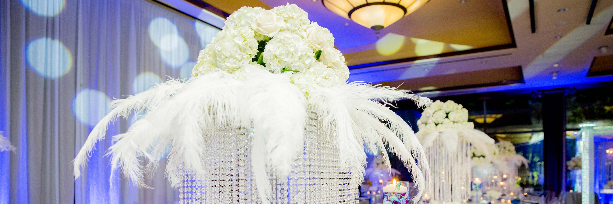 White Floral Arriangement Centerpiece Feathers Crystals