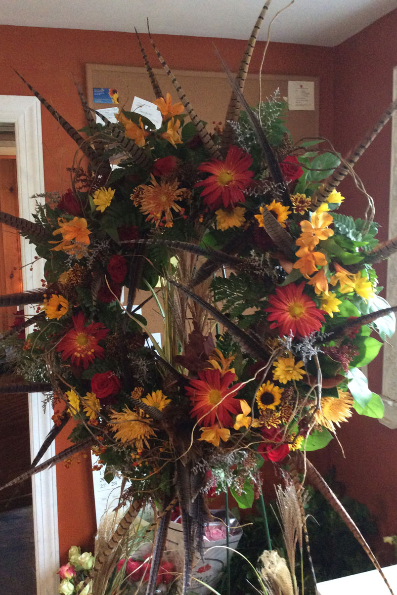 bright-natural-wreath-pheasent-feathers-fresh-flowers