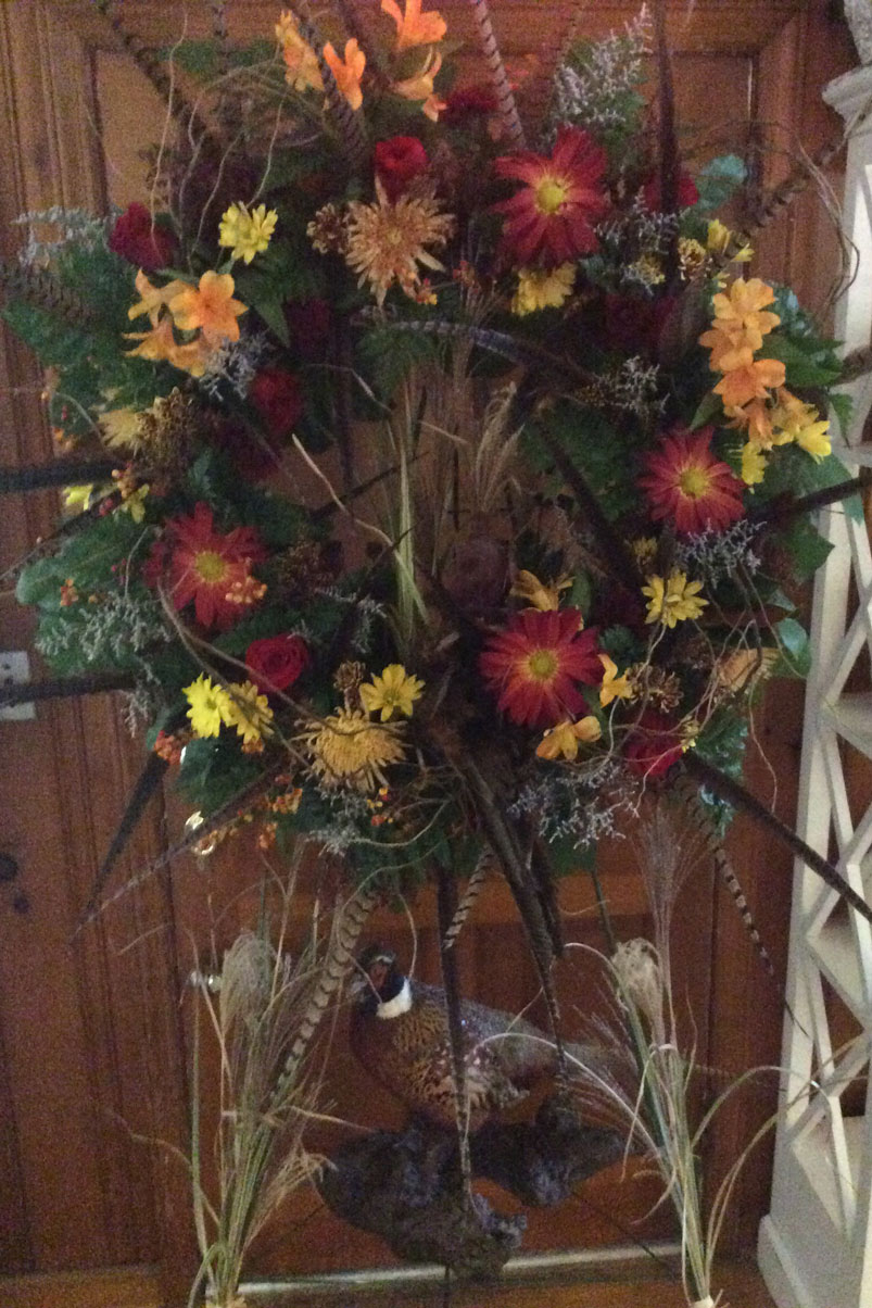 natural-wreath-fresh-flowers-greenery-red-orange-yellow-pheasent-feathers