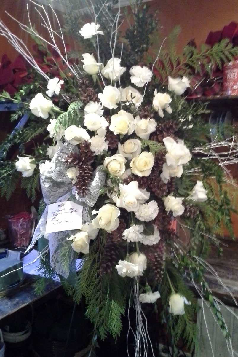 pinecones-white-roses-arrangement-branches