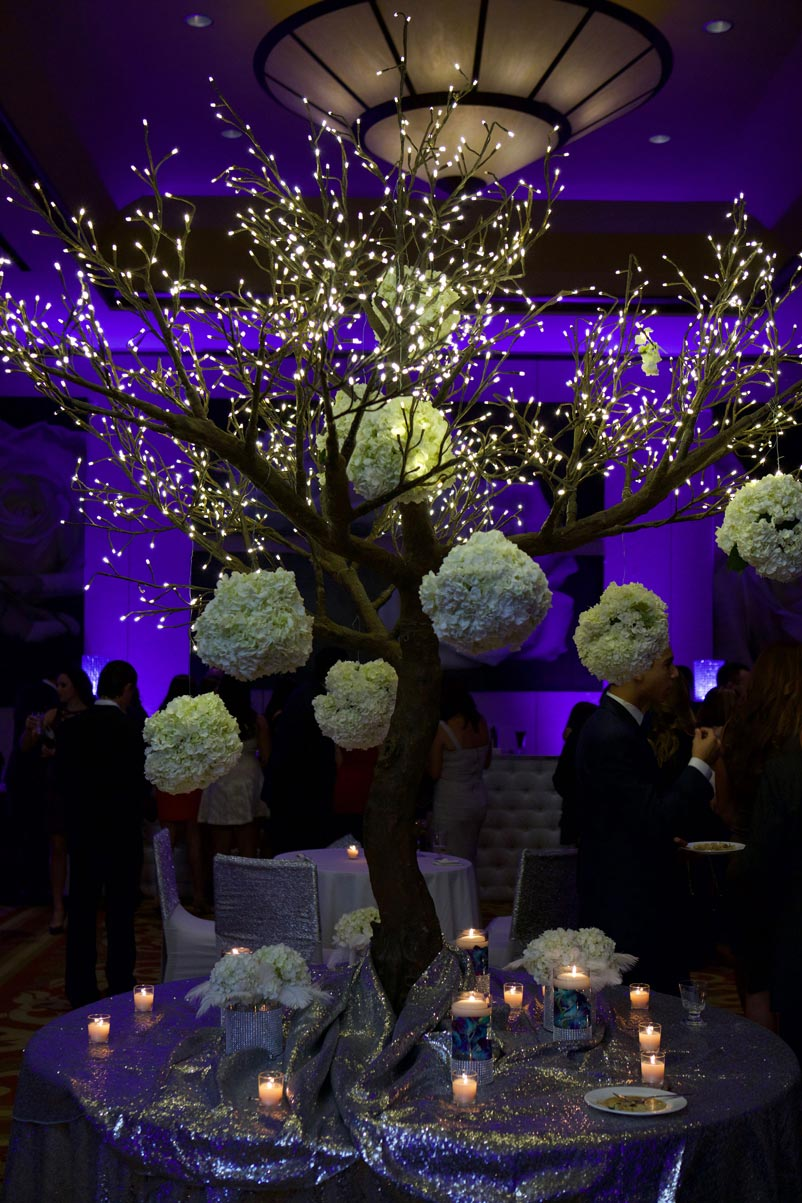 romantic-party-decoration-tree-lights-fresh-flowers