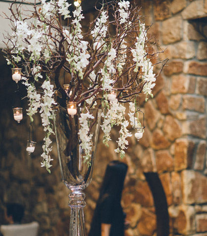 branch stick centerpiece flowers candles