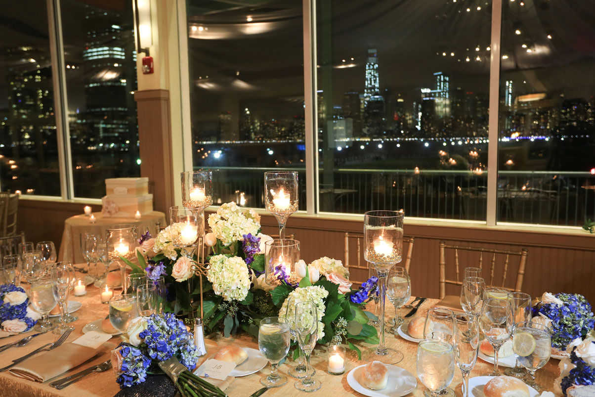 city-skyline-lights-fresh-flower-table-centerpiece-candles