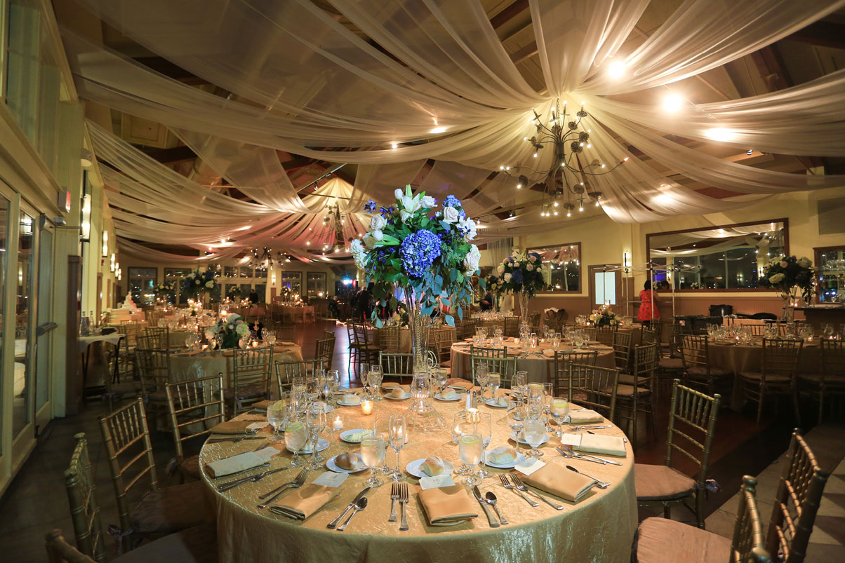 elegant-recpetion-draped-ceiling-chandeliere-flower-centerpieces-table-setting