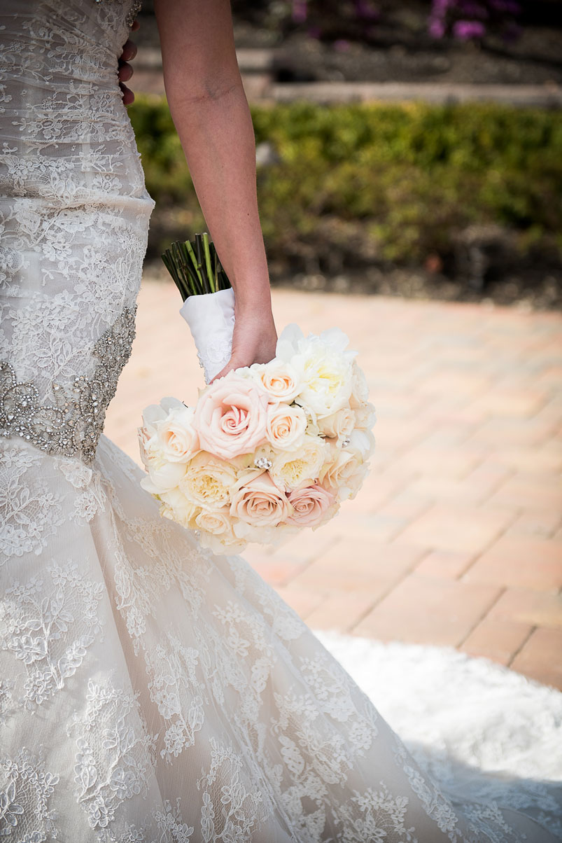 bride-holding-bouquet-at-side